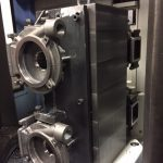 Machined parts mounted on tombstone.Doosan HP 4000 Horizontal Machining Center